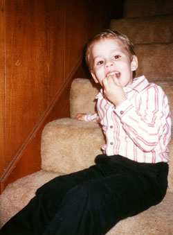 A Young Justin on the Stairs